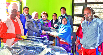 BSS distributes woollen clothes among needy persons