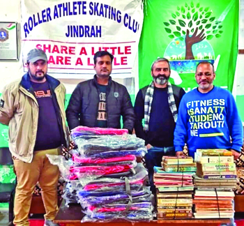 Roller Athletes distribute bags, books among students